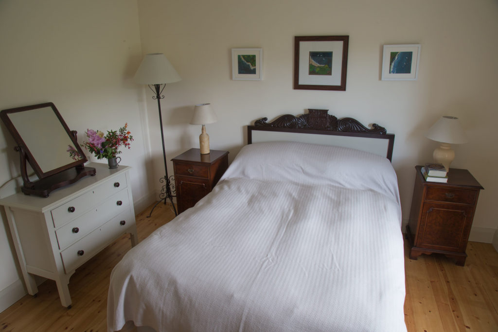 The two similar double bedrooms have queen sized beds and both look out over rolling fields, behind the house. All the beds have good quality mattresses, duvets and pillows (2 per person). There are extra blankets and hot water bottles in plentiful supply for the winter months.