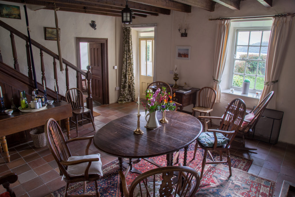The dining hall, with its open fire, has many traditional farmhouse features. The room retains its nineteenth century wooden beams, along with its original fireplace and staircase. It is the ideal spot for candle lit winter dinners in front of a warm turf fire.