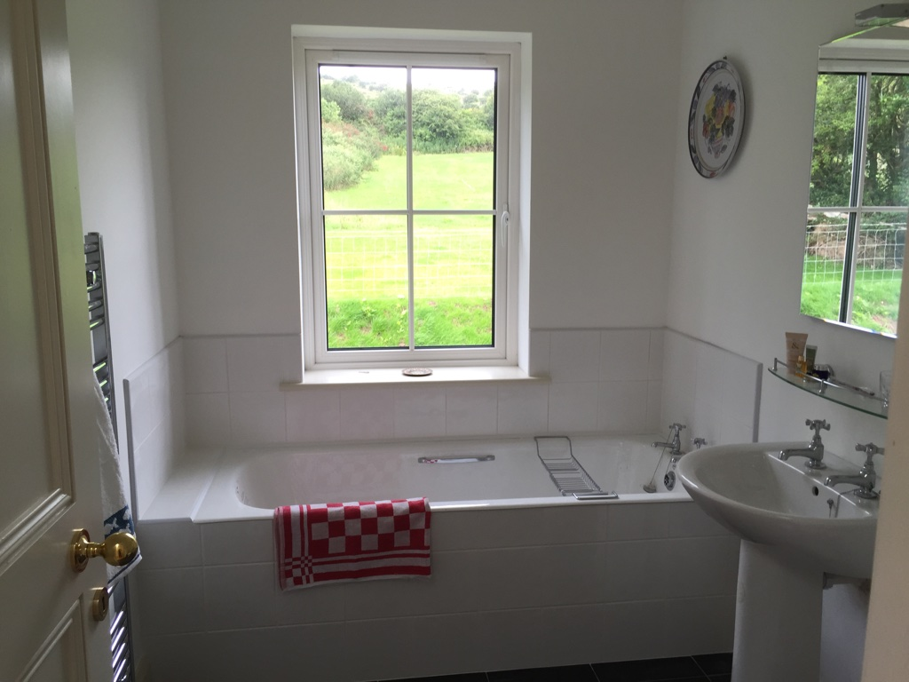 There are 4 decent sized bathrooms, 3 upstairs and one downstairs. The main upstairs bathroom has a cast iron bath and the other two have good sized showers. All the shower rooms and the bathroom are spacious, have electric heated towel rails and all have windows with views to the rear of the house.